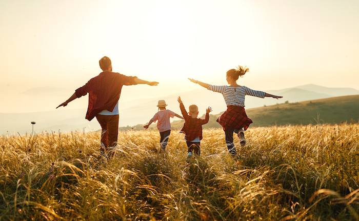 Heights of Harmony - family in field sunset
